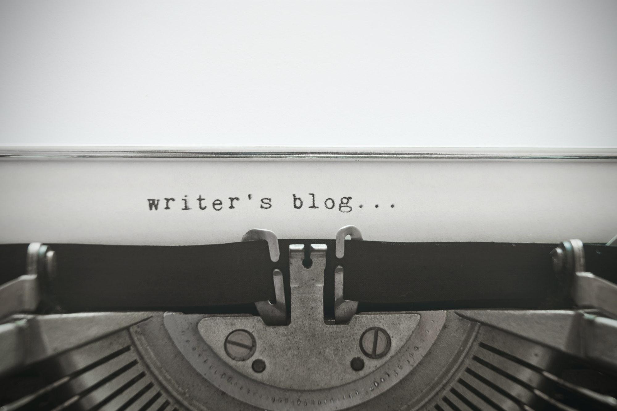 "Words ""writer's blog"" written with old typewriter"